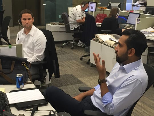 Indianapolis attorneys Chase Haller, left, and Syed Ali Saeed were among lawyers who answered question from Hoosiers who called the IndyStar Call for Action hotline last week. The free legal advice call-in program received more than 50 calls.