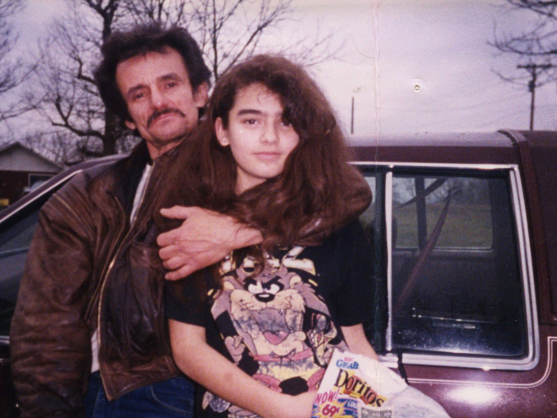 Bob Paillet, left, hugs his daughter Gena in this photo from the late 1980s or early 1990s.