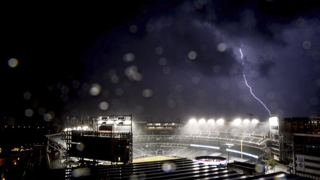 Rain and lighting halt an opening day baseball game between the New York Yankees and the Washington Nationals at Nationals Park on Thursday, in Washington.