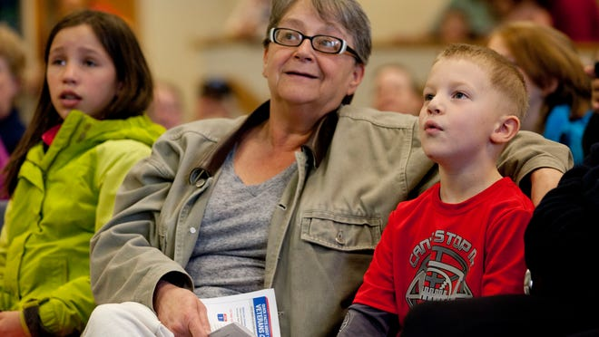 Caleb Hill, 5, of Port Huron, reacts when seeing a bat as he sits with his grandmother, Barb Gonzales, Tuesday at the St. Clair County Administration Building in Port Huron.