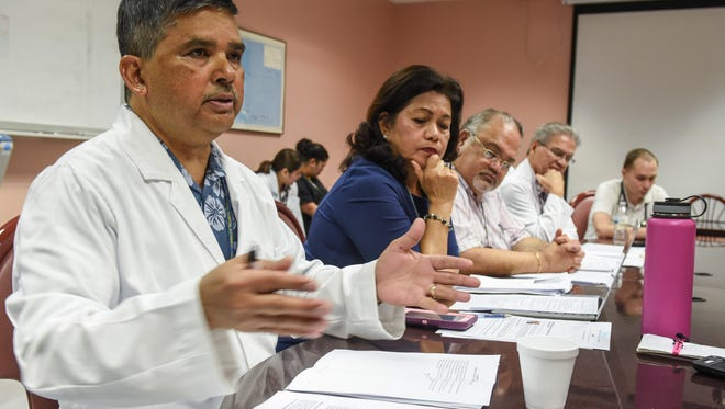 """Dr. Florencio """"Larry"""" Lizama, left, responds to allegations of mismanagement by hospital leadership at the Guam Memorial Hospital during a press conference at the healthcare facility on Tuesday, June 12, 2018."""