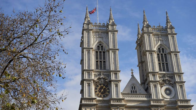 Britain's Union Flag flies at half mast above Westminster Abbey in central London on Nov. 16, 2015.