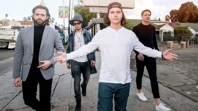 Lukas Graham Forchhammer, center, and his bandmates.