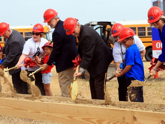 School board members from Gregory-Portland Independent School District and students from W.C. Andrews Elementary School turn shovels of dirt during the groundbreaking ceremony  for a new building Tuesday, May 16, 2017, in Portland.