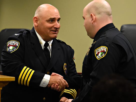 York City Police Chief Wes Kahley, left, presents the