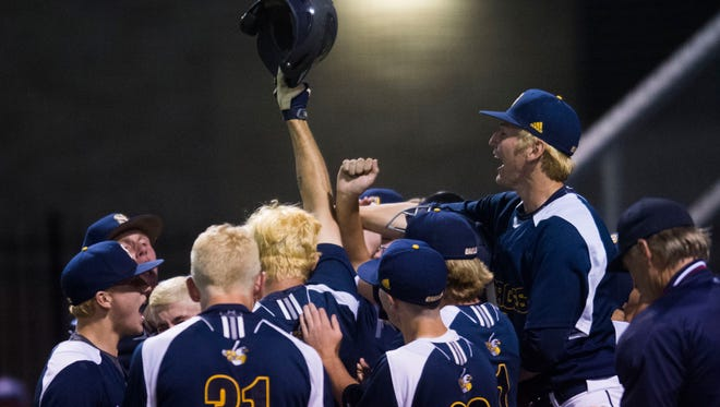 Seymour player congratulate Nathan Payne (4) on his home run during a Class AAA TSSAA Baseball State Tournament game between Seymour and Brentwood in Murfreesboro Tuesday, May 22, 2018. Seymour defeated Brentwood 3-2 with a run in the seventh inning.