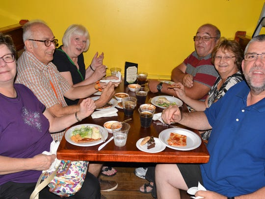 Customers enjoy the food at Hermann's Olde Town Grill