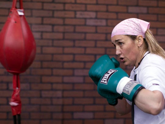 In this photo taken Friday, Feb. 11, 2011, boxer Christy Salters works out at the Top Rank gym in Las Vegas. Just months after being stabbed and shot by her husband, Salters returned to the ring on March 12, 2011, and fought Dakota Stone as the first fight on the pay per view card headlined by Miguel Angel Cotto and Ricardo Mayorga.