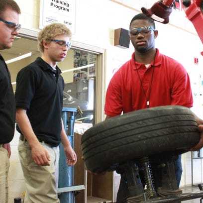 Students work in the auto shop during class at South