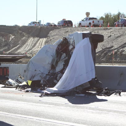 A woman was killed after her overturned minivan was