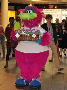 Sparks is accompanied by library officials as he makes a special delivery of mascot dolls, provided by the Ocean County Library Foundation. The dolls are available for purchase at all branches.