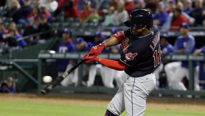Cleveland Indians' Francisco Lindor connects for a grand slam off of Texas Rangers closer Sam Dyson in the ninth inning of a baseball game in Arlington, Texas, Wednesday, April 5, 2017. The shot scored Abraham Almonte, Carlos Santana and Tyler Naquin in the 9-6 Indians win. (AP Photo/Tony Gutierrez)