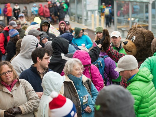 Hundreds line Cherry Street waiting for the new L.L. Bean store on  in Burlington to open Friday morning.