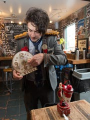 Mario the Magician (Mario Marchese) prepares his act at Gypsy Donut in Nyack on Tuesday, Jan. 12, 2016.