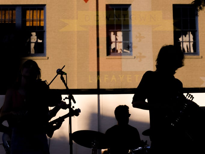 Musicians in Feufollet  silhoutted against the wall