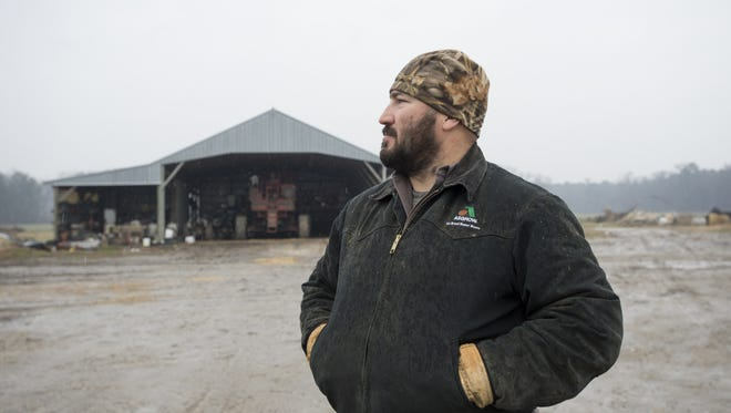 Brian Johnson of Westover poses at his farm in this 2014 photo. Johnson was one of 34 farmers honored Thursday, Jan. 19, with a Century Farm designation.