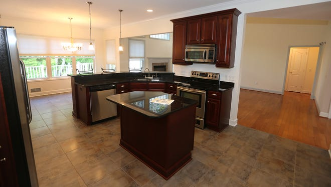The  kitchen opens into the dining area and a living area in this Webster house.