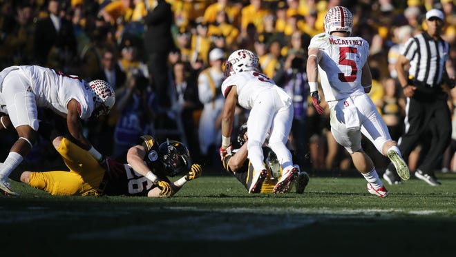 Stanford running back Christian McCaffrey runs a punt return for a touchdown against Iowa on Friday, Jan. 1, 2016, at the Rose Bowl in Pasadena, Calif.