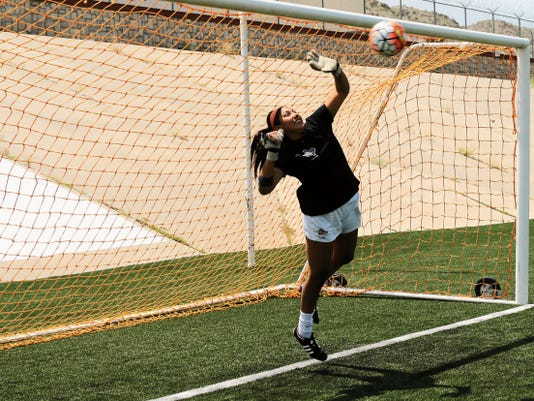 RUBEN R. RAMIREZ—EL PASO TIMES Alyssa Palacios, goal keeper for the 2015 UTEP soccer team blocks a penalty kick during the 6th Annual Media Day penalty kick challenge.