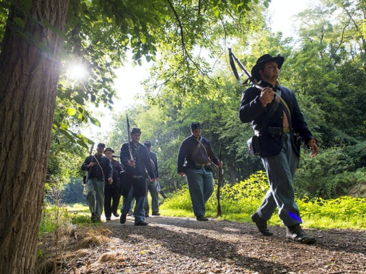 Members of the 93rd Pennsylvania Volunteer reenactors walk along the Union Canal in North Lebanon Township on Monday, August 3, 2015. The group is preparing for their upcoming event at the Union Canal Tunnel Park on August 21-23.