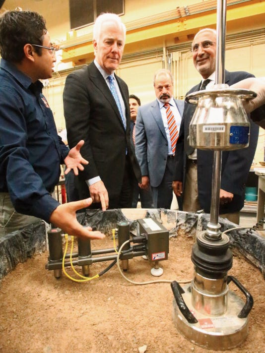 U.S. Sen. John Cornyn, second from left, listens to a presentation on soil testing for roadway construction from Prajwol Tamrakar, left, a research assistant in the Center for Transportation Intrastructure Systems on Monday at the University of Texas at El Paso. With Cornyn is, right to left, Dr. Soheil Nazarian, of the UTEP Civil Engineering Department, and Mayor Oscar Leeser.