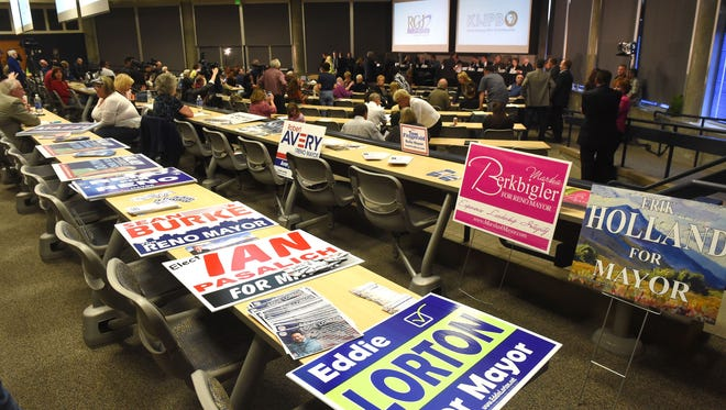 Campaign signs outside a Reno mayoral candidate forum in April.