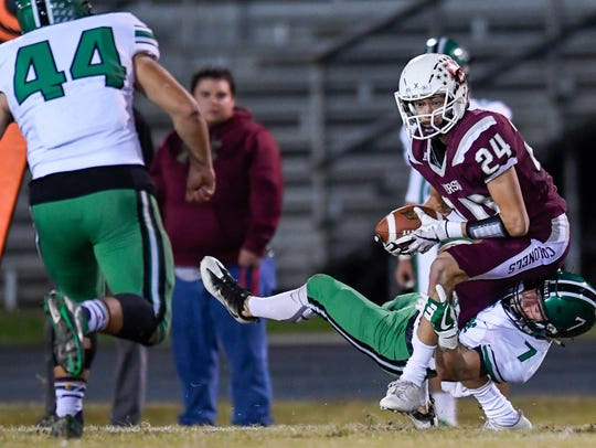 Henderson's Max Hargis (24) looks for more yards after