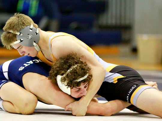 Central York's Logan Paluch, top, won the 126-pound title over the weekend at the Penn Manor Tournament. DISPATCH FILE PHOTO