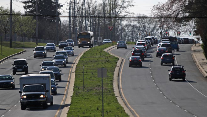 Rush-hour traffic flows along Lancaster Pike at Centerville Road on Wednesday in Greenville. A judge recently ruled on a housing development on the former Hercules Country Club site.