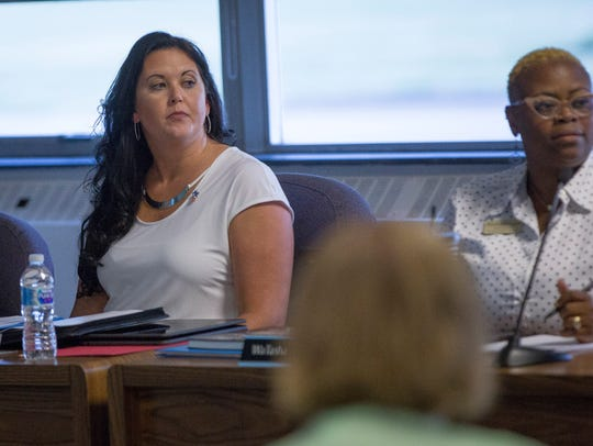 Brittany Bales listens to her fellow board members