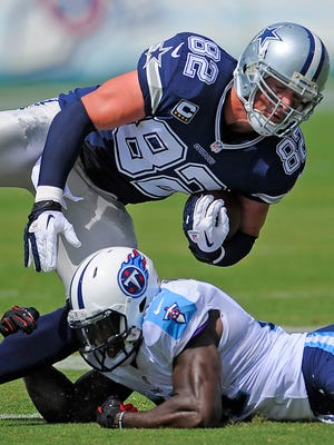 Cowboys tight end Jason Witten (82) is tackled by Titans strong safety Bernard Pollard (31) as the Tennessee Titans play the Dallas Cowboys Sunday Sept. 14, 2014, in Nashville, Tenn.