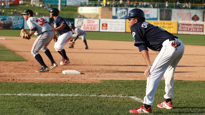 Blue Claws shortstop J.P. Crawford, out with a finger injury, coaches first base during the Blue Claws 3-1 win over the Rome Braves. Crawford missed his fourth straight game.
