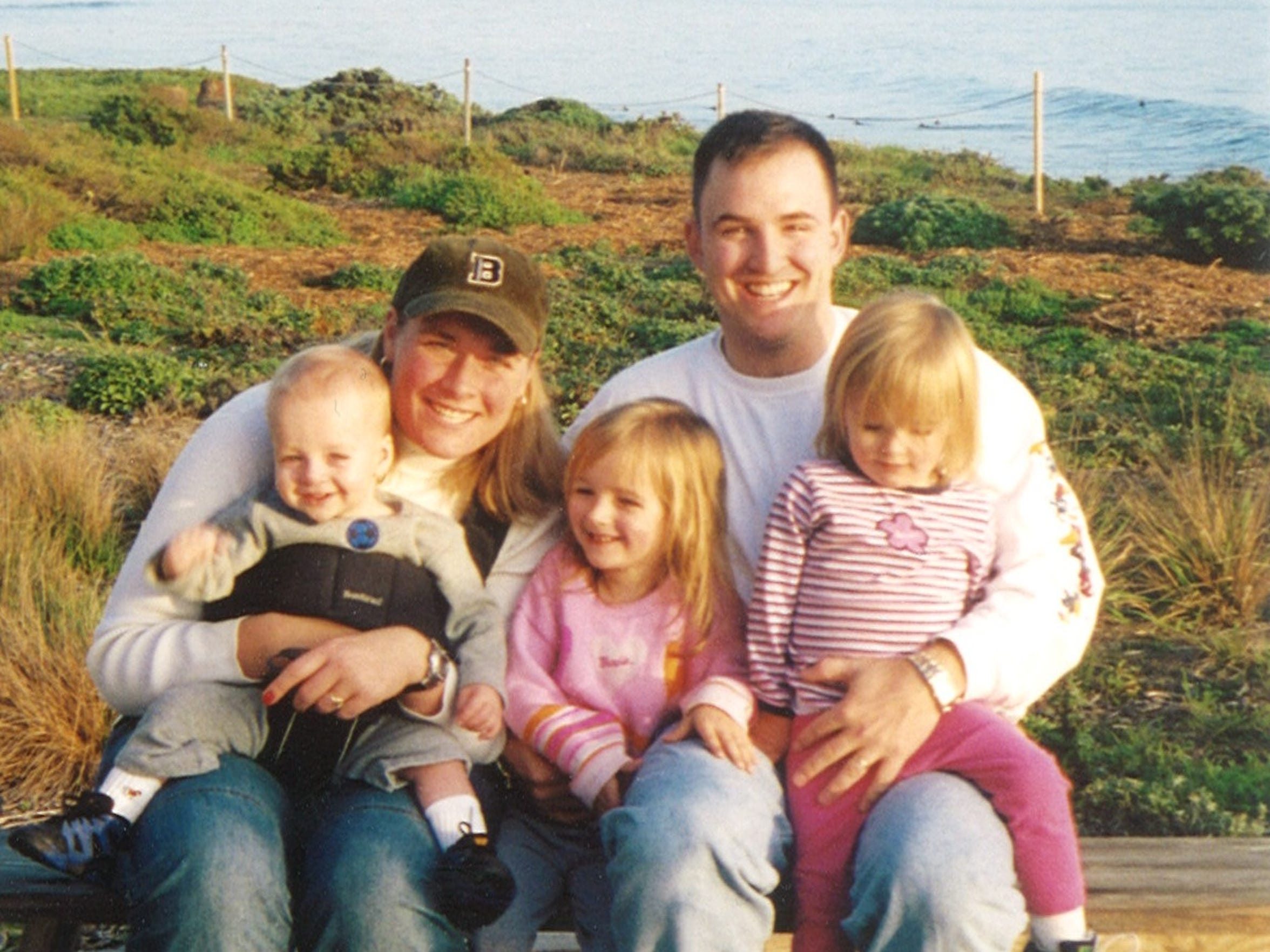 Emily and Devon Reese with their children.