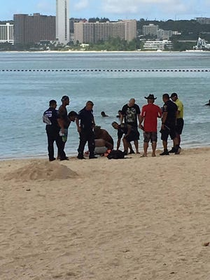 Guam Fire Department personnel respond to a reported drowning at Ypao Beach in Tumon on Sept. 25.