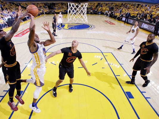 Golden State Warriors' Andre Iguodala, second from left, drives to the basket against the Cleveland Cavaliers during the second half in Game 5 of basketball's NBA Finals Monday, June 13, 2016, in Oakland, Calif. Cleveland won 112-97. (AP Photo/Marcio Jose Sanchez)