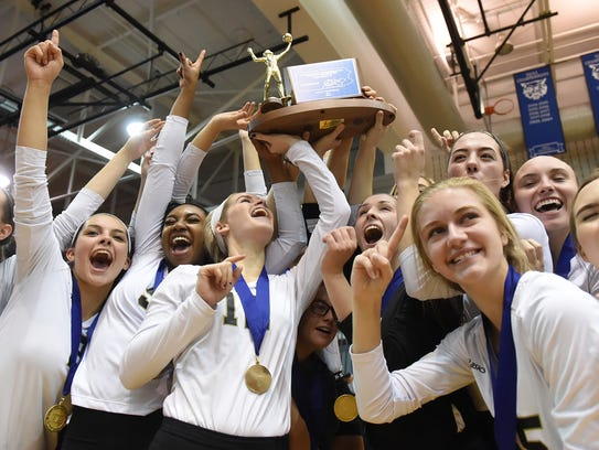 The Delone Catholic girl's volleyball team hoist up