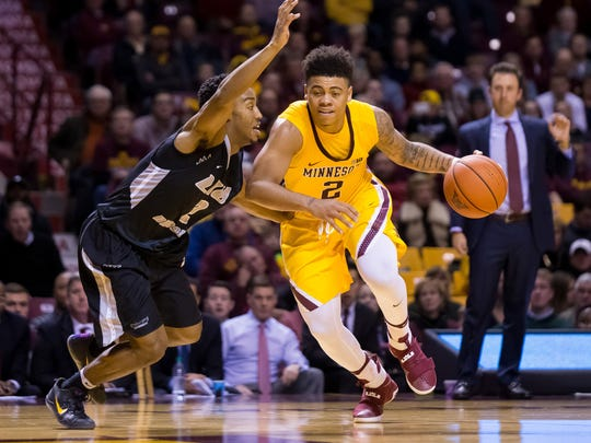 Minnesota Gophers guard Nate Mason (2) dribbles in the second half against LIU Brooklyn Blackbirds guard Jashaun Agosto (2) at Williams Arena. Minnesota won 76-66.