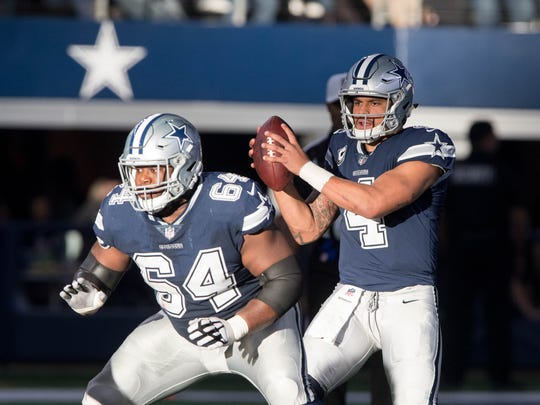 Dallas Cowboys guard Jonathan Cooper (64) and quarterback Dak Prescott (4) in action during the game against the Los Angeles Chargers at AT&T Stadium. The Los Angeles Chargers defeat the Dallas Cowboys 28-6.