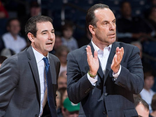 Notre Dame assistant coach Martin Ingelsby (left) speaks to coach Mike Brey during a game this season.