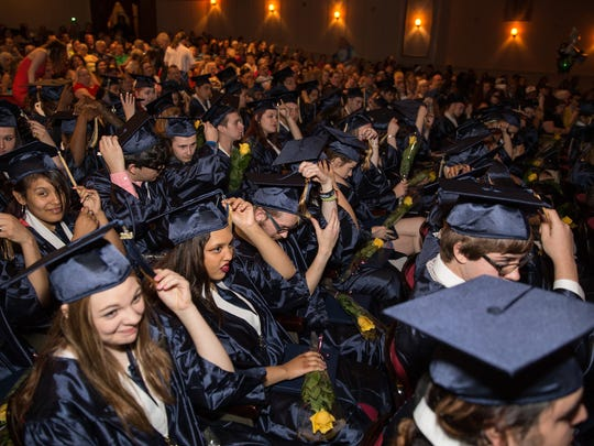 Scavo High School students celebrate graduation in 2016.