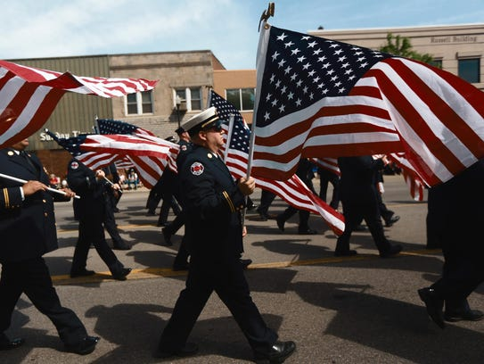 The Dearborn Fire Department Color Honor Guard marches