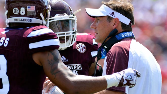 Sep 3, 2016; Starkville, MS, USA;  Mississippi State Bulldogs wide receiver Fred Ross (8) and linebacker J.T. Gray (12) talk with head coach Dan Mullen during the second quarter of the game at Davis Wade Stadium. Mandatory Credit: Matt Bush-USA TODAY Sports