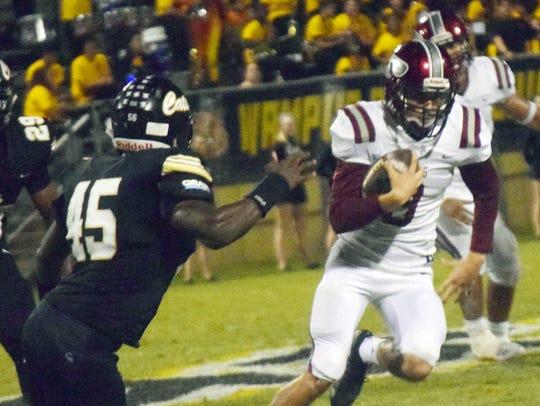 Pineville receiver Jacob Sylvia (3) avoids a tackle