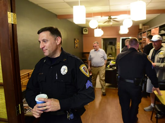 "Chambersburg interim police chief Richard Morrissette chats with visitors during the ""Coffee with a Cop"" event held Friday, March 11, 2016 at C & C Coffee shop, North Main Street, Chambersburg."