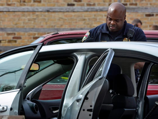 York City Police Officer Sheldon Hooper searches a
