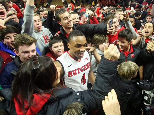 Then-Rutgers men's basketball star Myles Mack was swarmed