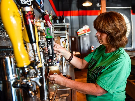 Missy Meddings fills a beer order at Twenty-Nine BrewPub