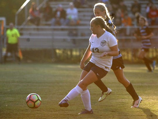 Madison Academic's Camryn Meyer (13) kicks the ball forward during a Class A-AA sectional match against South Gibson at the University of Memphis Lambuth in Jackson, Tenn., on Saturday, Oct. 22, 2016.