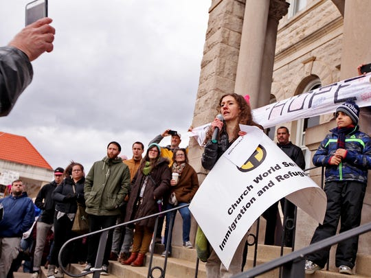 "Rebecca Sprague, community program coordinator at the Harrisonburg Immigration and Refugee Office of the Church World Service speaks to the crowd at the ""United We Stand With Immigrants and Refugees"" rally on Court Square in Harrisonburg on Sunday, Jan. 29, 2017."