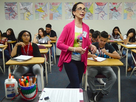 Adria Hernandez, a teacher and the head of the foreign languages department at Ysleta High School, conducts a Spanish class Friday at the Lower Valley School.